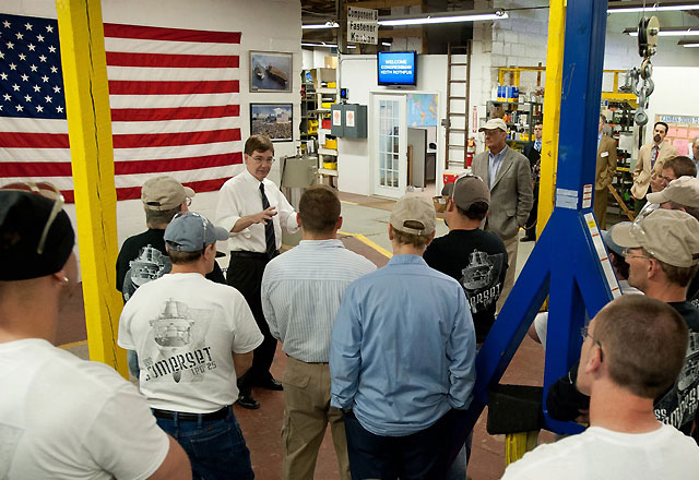 Congressman Keith Rothfus speaking with manufacturing workers.